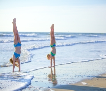 Hand Stands on Virginia Beach